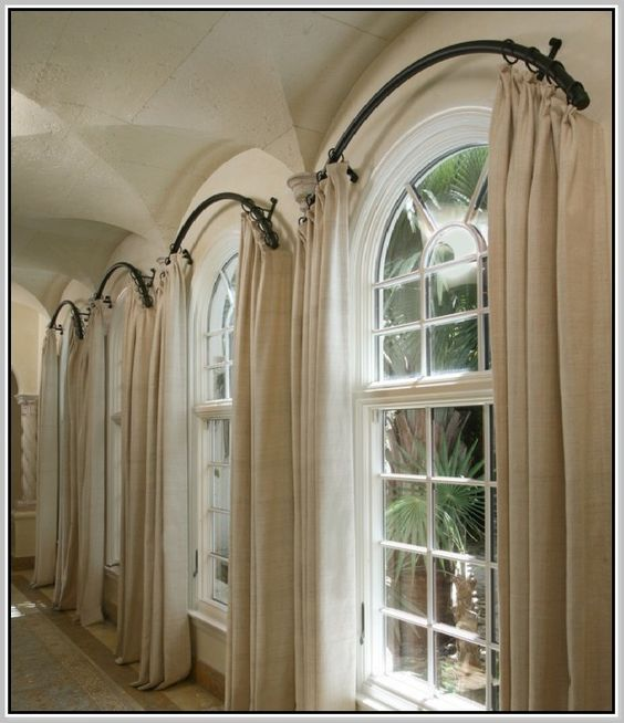 Urved shower curtain rod to make a window look bigger for How to decorate an arched window