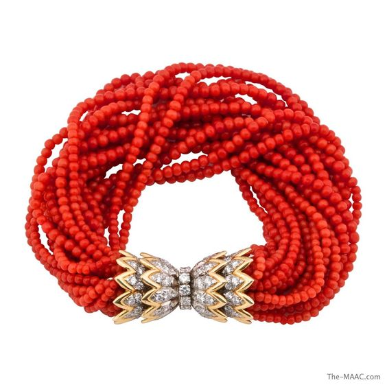 """Tiffany & Co. Schlumberger coral and 18k gold Torsade bracelet, French, circa 1970""""s. Coral, 18K gold, diamonds, platinum.  Length: 8 inches Width: 1 inch"""
