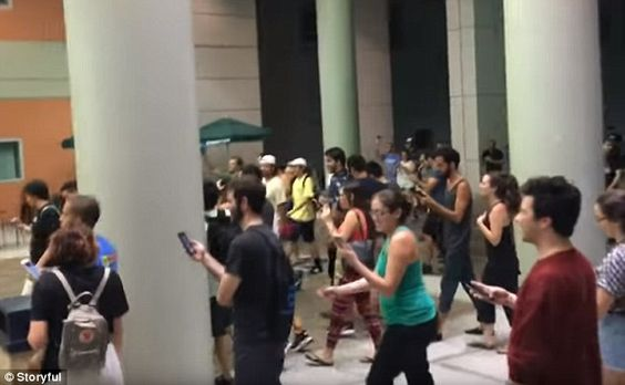 As Pokemon Go's popularity reaches hundreds of students at Florida International University were filmed wandering round the campus en masse in search of a single Pokemon on Sunday