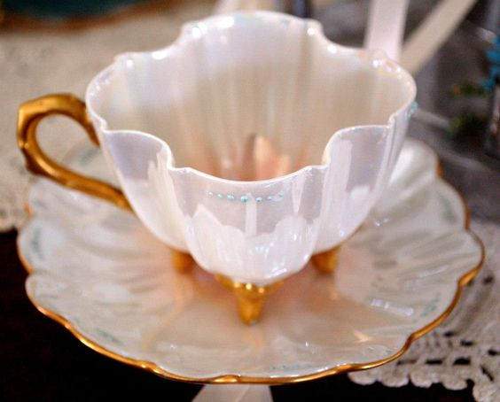"""This petite little teacup is my very favorite one I've ever found!  It's got a lovely pearlized finish and little blue bubbles.  I call it my """"mermaid teacup.""""  It was made by Limoges and an internet source dates the mark from between 1892-1907.  I'm not really sure I believe it's that old, but regardless, I really love it! quoted from Lauren's blog."""
