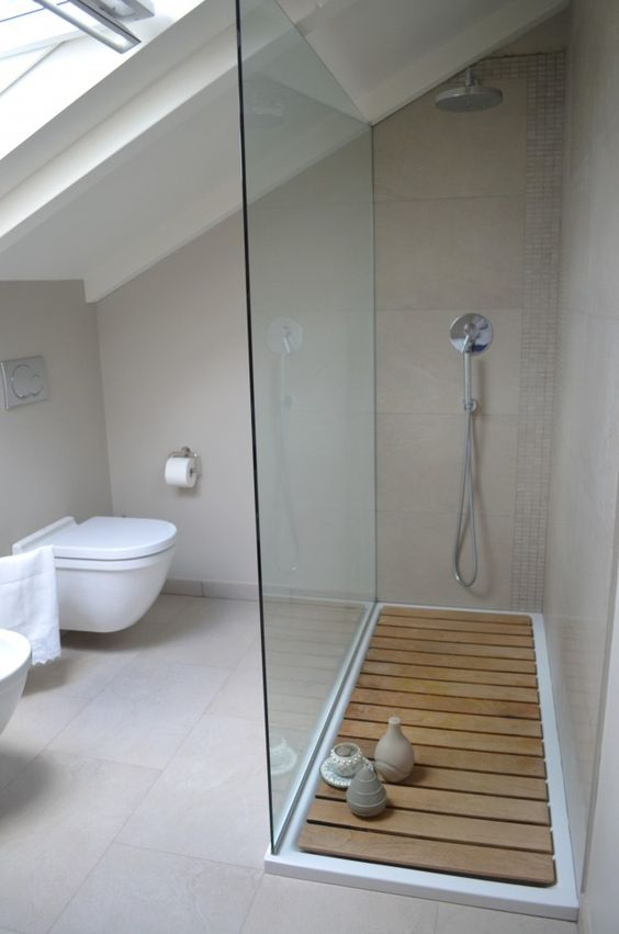 Glass shower wall, sunk-in floor even with rest of bathroom and walk-in, no door.: