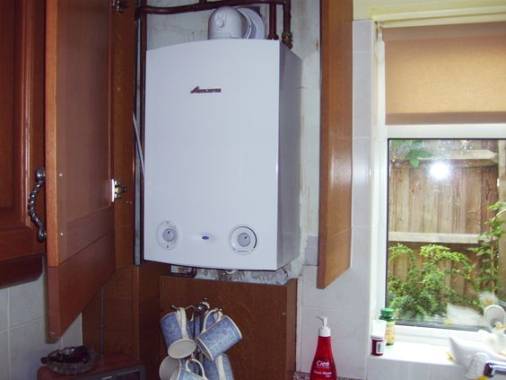 Combi boiler install neatly installed inside cupboard for Kitchen boiler cupboard