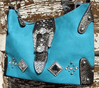 Turquoise soft faux leather Augusta Bling Bag    Large rhinestones decorate the front, single handle, three piece buckle set, lined with silky paisley fabric. Top zipper, back outside zipper pocket