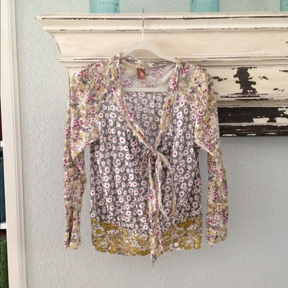 Anthropologie Language top Good preowned condition super cute mixed floral patterns ties at the bustline ! so many details just your perfect cotton tee ! Anthropologie Tops