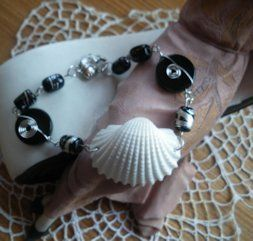 'Handcrafted Bracelet made by ELKIRA SHELLS' is going up for auction at 12pm Sun, Jul 1 with a starting bid of $15.