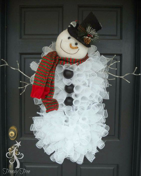 This handmade Christmas snowman is made out of rolls and rolls of mesh with a cute carrot nose and a jaunty hat!