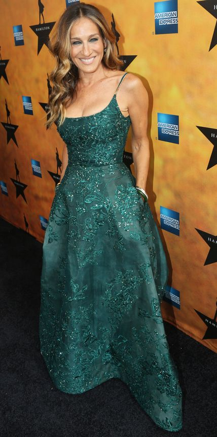 """For the opening night of the Broadway show """"Hamilton"""" in New York City, Sarah Jessica Parker wowed in an elaborately embroidered Elie Saab Haute Couture ball gown complete with pockets. Parker accessorized with matching green and white bangle sets worn on both arms while sultry eye makeup and tousled curls finished off the look."""