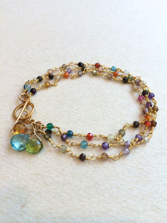 3 strands of tiny cubic zircons surround your wrist in this colorful bracelet. The gold fill toggle makes it easy to get on and off, while