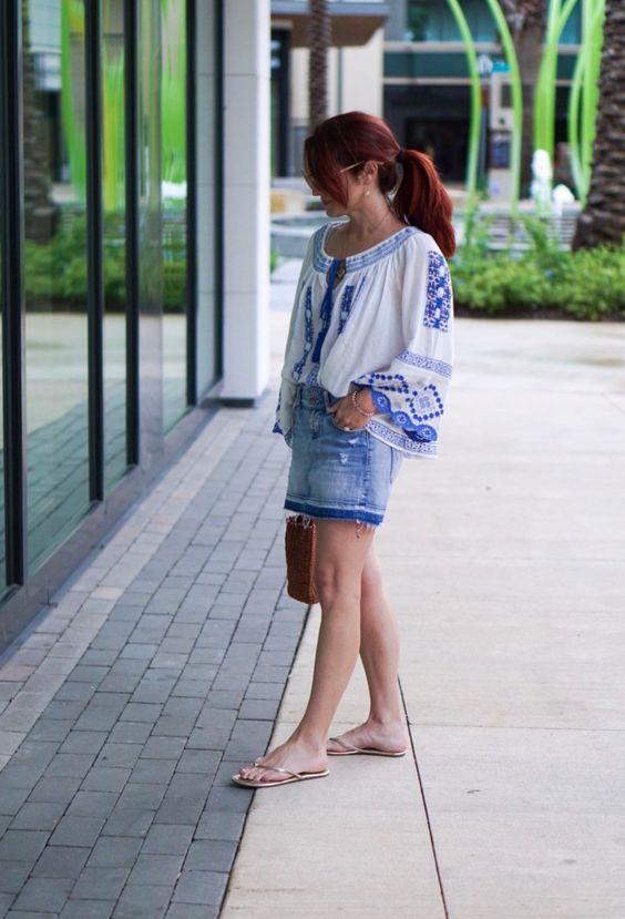 blue and white blouse, flip flops, casual pony tail, red hair,