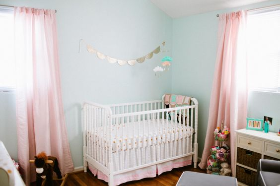 Sweet blue and pink nursery with pops of gold
