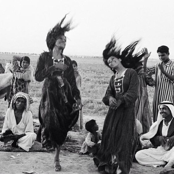 by Inge Morath. Gypsies dancing in a camp near Ctesiphon, Iraq, 1956.