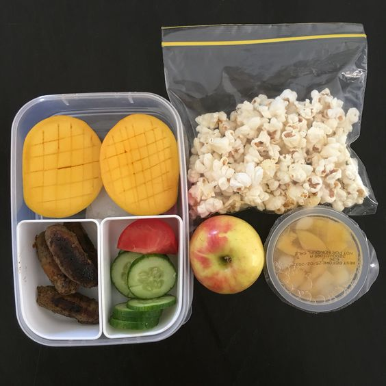 Kids lunch boxes today:  fruit break: apple  morning tea: popcorn (homemade with just a sprinkle of good salt) & fruit tub (organic just from the supermarket)  lunch: sausages, cucumber, tomato & mango  #cutoutthecrap #lunchbox #lunch #morningtea #happykids #kidsfood #glutenfree #dairyfree #preservativefree #additivefree #grateful #mango #lovesummerfruit #collettewhite