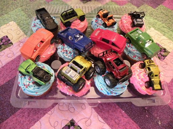 Ok, an odd order but whatever!  Vanilla with pink frosting, red velvet with blue frosting -filled with marshmallow cream inside --topped with off-road vehicles of all things! To each their own!