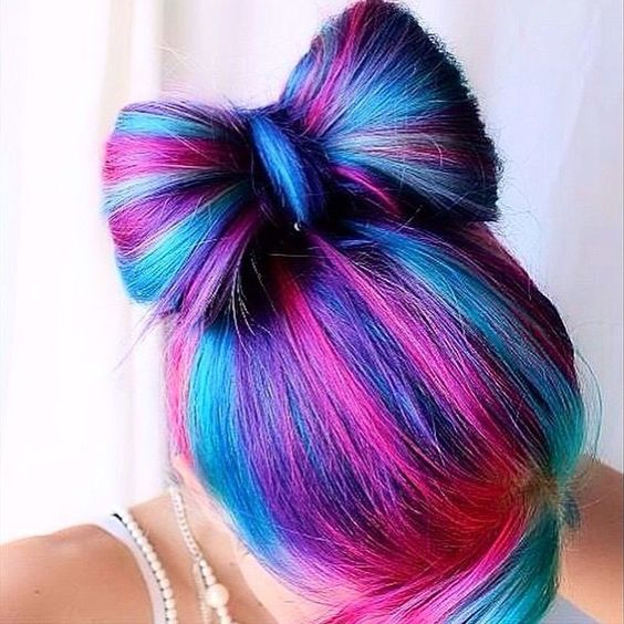 Pink and different shades of blue and purple. Dyed hair. Color. Colour. Now hair bun. Hairstyle.: