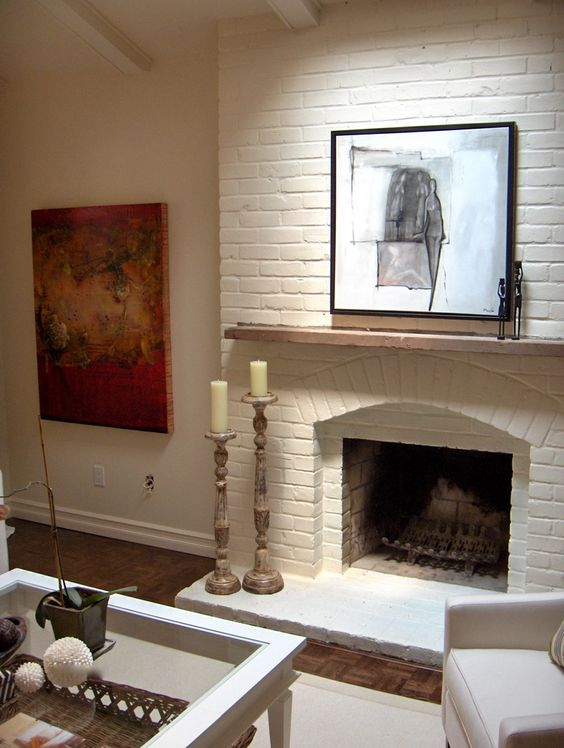 Painting the brick fireplace the same color as the walls - How to make a brick fireplace look modern ...