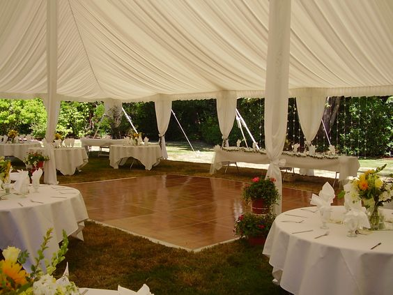 Add a tent liner and leg drapes for your event tent. A tent liner is a soft, billowy, white fabric lining that is installed ...