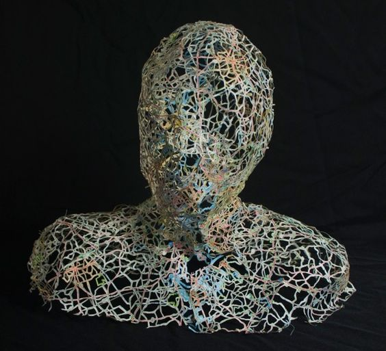 Nikki Rosato creates these incredibly delicate busts using the mesh from cut-out street maps