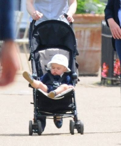 ourlittlegeorge: Prince George is taken for a stroll by his nanny Maria Teresa Turrion Borrallo round Hyde Park pond, June 11,2014: