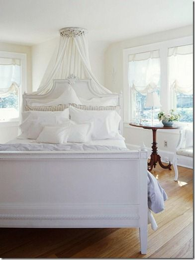 Could build a canopy kind of like that behind the bed frame