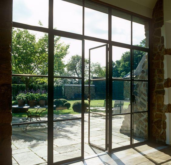love the view of backyard from steel doors...JohnMinshawDesign