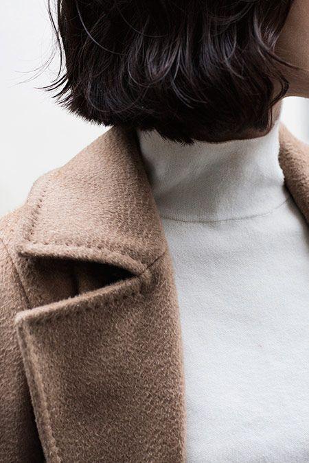 camel coat + white turtleneck: