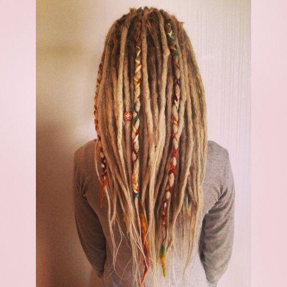 Dreadlocks with yarn braids as decorations