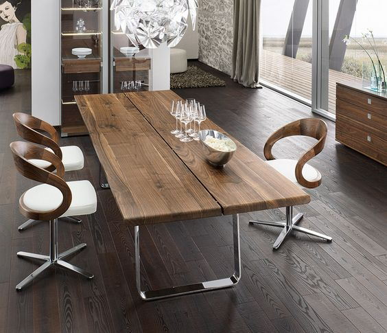 Team 7 luxury walnut metal dining table. Available from German Kitchens Limited in Wellington, NZ