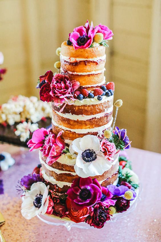 MEREKI + NICK // #cake #dessert #reception #flowers #nakedcake #colourful #quirky #floral #tier #rustic #bright #poppies