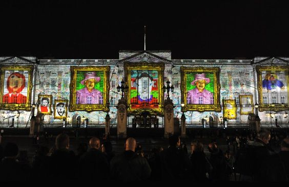 Celebrating the Queen's 86th birthday with lights show at Buckingham Palace.