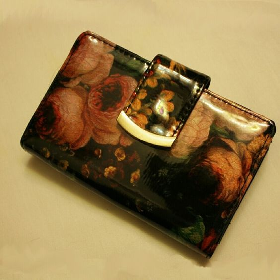Shiny patent floral wallet NWT Shiny & sleek floral walket. Snaps shut, a lot of card space. Bronze clasp coin pocket. NWT. Made by Mundi, originally $36 Bags Wallets