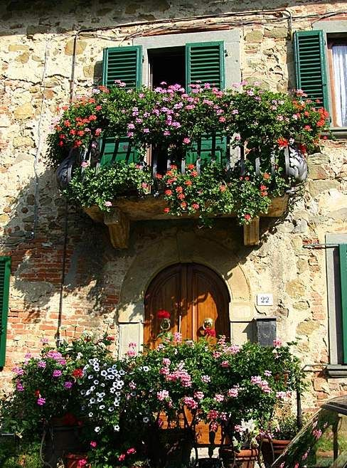 Some of the things I found so enchanting about Italy when I was there, were balconies covered in flowers. I want to go back to Sicily some day before I'm to old!