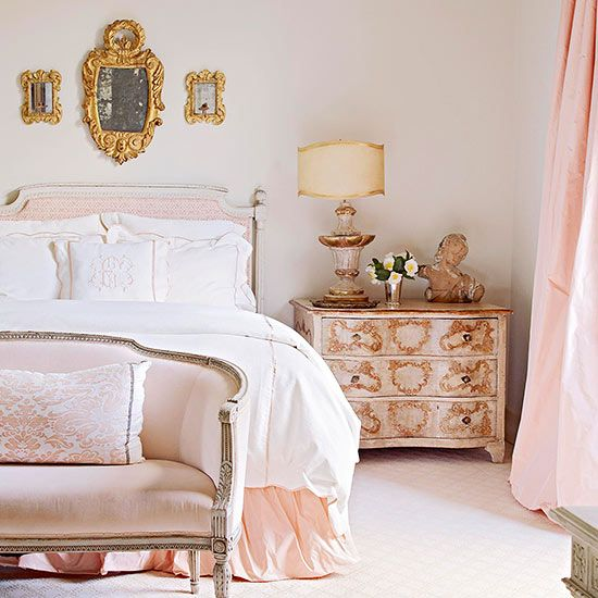 Awash in soft pinks and warm golds, this bedroom looks like the perfect place to unwind after a long day: http://www.bhg.com/rooms/bedroom/master-bedroom/beautiful-boudoirs/?socsrc=bhgpin031614romanticretreat&page=14: