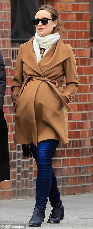 {What a great coat! Timeless and shapeshifting.} Maternity chic: Olivia Wilde dressed her very pregnant belly in a camel coat as she strolled around NYC on Monday.: