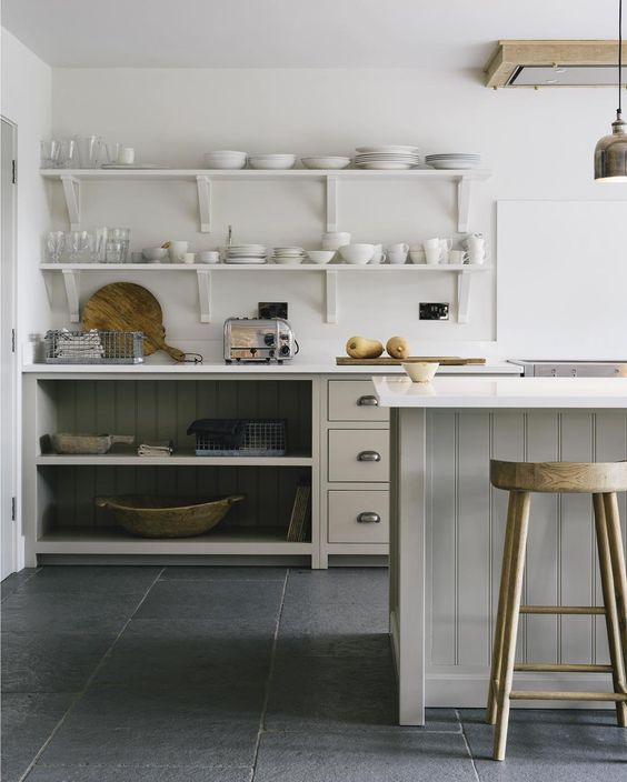 Simple open shelving and beautiful neutral colours, kitchen bliss #deVOLKitchens. Come be inspired by 11 White Kitchen Design Ideas Adding Warmth! #kitchendesign #whitekitchen #kitchenideas #interiordesignideas #whitekitcheninspiration