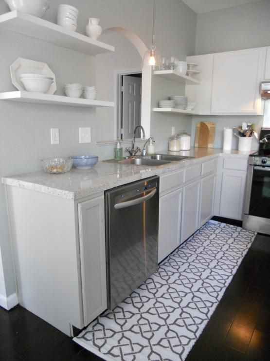 white, open shelving in the kitchen