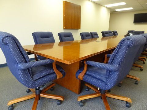 Traditional classic conference boardroom with matching wood and complementary soft conference chairs by connecting · furniture plansoffice