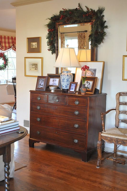 Chest With Photos Want To Rearrange Living Room And Put My Gold Mirror Over That Desk By The