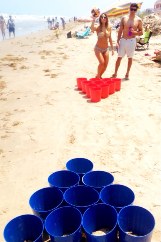 I saw this in Destin with tennis balls, beer pong on the beach. I will do, except with purple and gold!