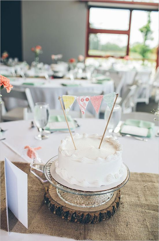 Mini cake and bunting at each individual guest table. #weddingcake #cakeideas #weddingchicks Cake By: Golden Delight Bakery ---> http://www.weddingchicks.com/2014/04/29/a-wedding-cake-dilemma/