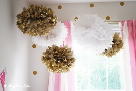 gold white poms in room