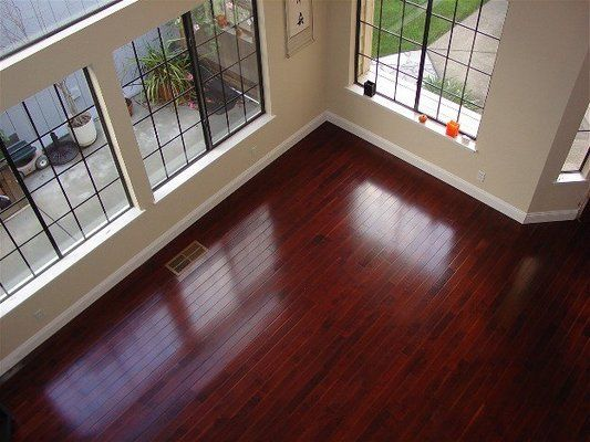 This dark brazilian cherry hardwood floor has been refinished by Rafal Maleszyk at Da Vinci Floors