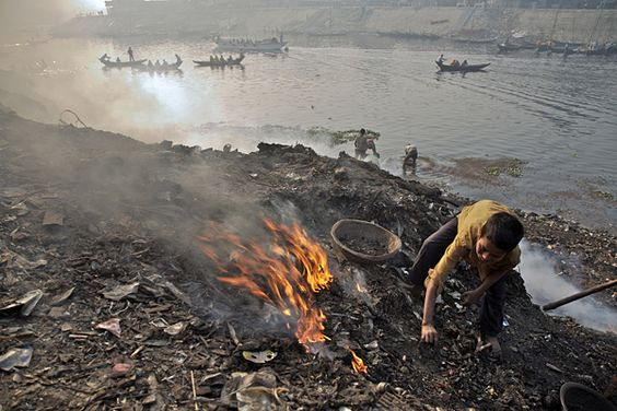 An estimated 215 million children around the world are required to work – often in highly exploitative or hazardous conditions. A boy burns garbage to extract scrap metal to sell in Bangladesh. Photo: ©UNICEF/Shehzad Noorani