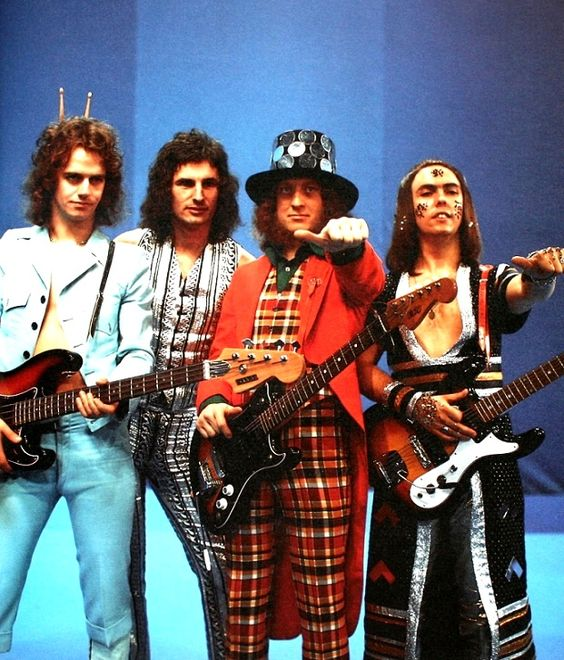 Anyone remember the 70s band Slade??Slade ~ great 70s glam rock band!! ~ Slade rose to prominence during the glam rock era of the early 1970s with 17 consecutive top 20 hits and six number ones. The British Hit Singles Albums names them as the most successful British group of the 1970s based on sales of singles. They were the first act to achieve three singles enter at number one. http://www.guitarandmusicinstitute.com