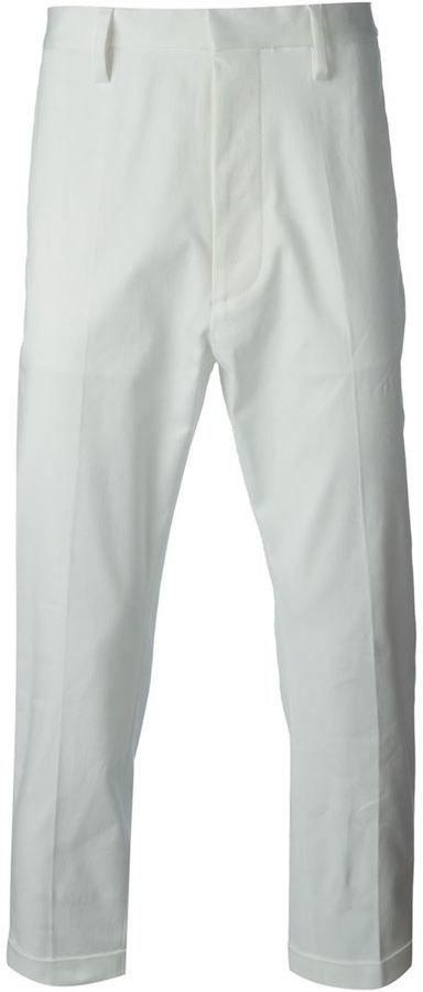 $247, White Chinos: DSQUARED2 Chino Trousers. Sold by farfetch.com. Click for more info: http://lookastic.com/men/shop_items/136892/redirect