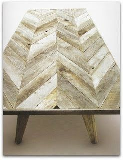 I like! This cool coffee table is made from weathered wood pieces cut in a chevron design.