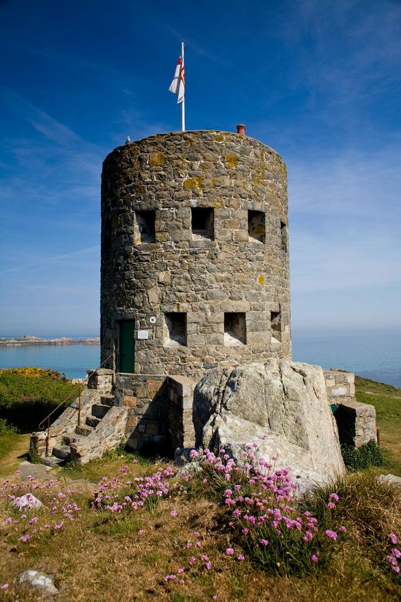 Martello towers (or loophole towers) started appearing on Guernsey's coast at the end of the 18th century under the threat of attack by Napoleon. This one is at L'Ancresse Bay.: