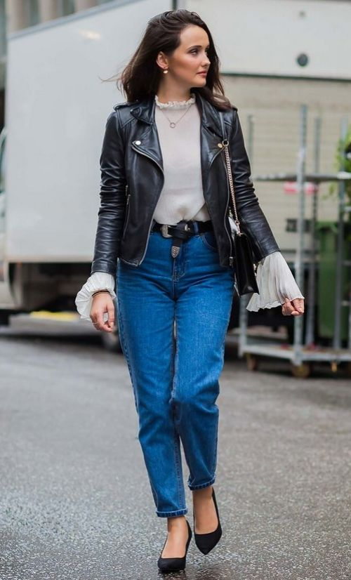 Indigo jeans and a black leather moto jacket. See more street style from Stockholm Fashion Week. Photographed by Photographed by Acielle / Style du Monde.