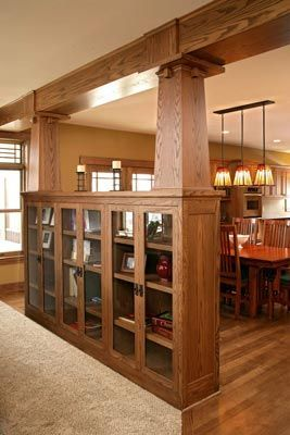 Bookcase built in with craftsman pillars to keep it open to the next room. For the basement
