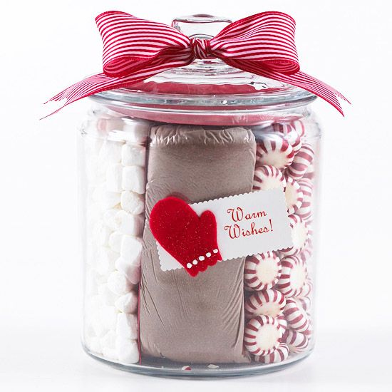 Make a quick, inexpensive craft that's perfect for the holiday season. Place bagged cocoa mix in the middle of a clear jar with lid and fill the sides with peppermints and marshmallows. Finish with a simple bow and tag for a pretty and tasty gift.