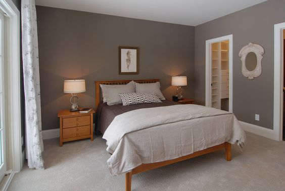Gray bedroom with artwork beige carpet beige shams for Paint colors for brown carpet